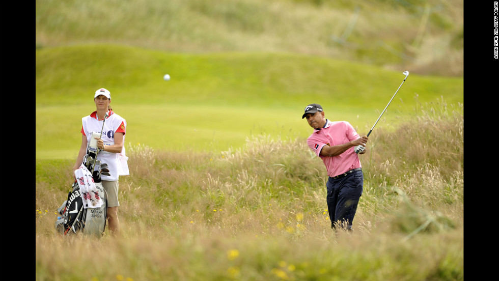 India's Keev Milkha Singh tries to escape from deep rough.