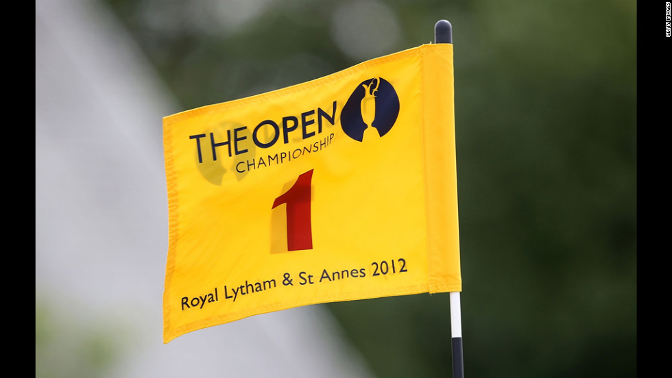 Wind whips the flag on the first green at Royal Lytham and St. Annes.