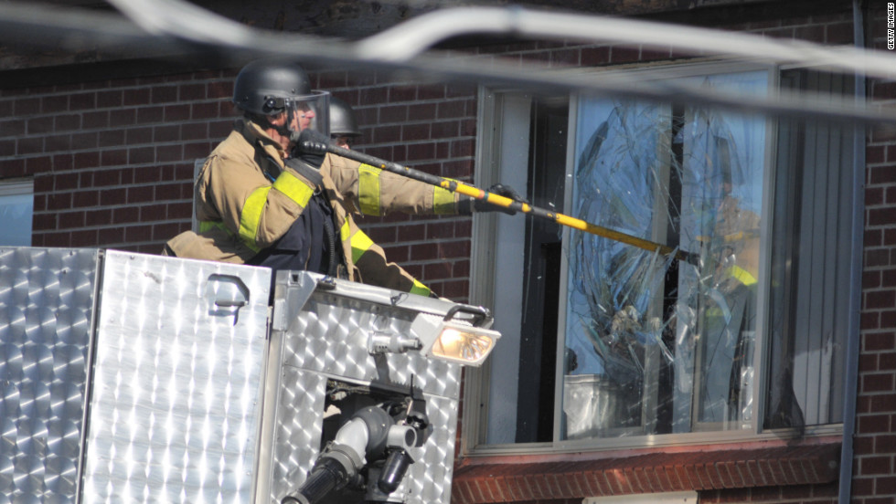 Police break a window at the suspect's apartment July 20, 2012, in Aurora.
