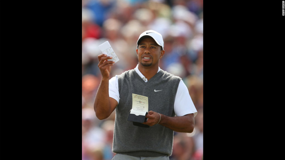 Tiger Woods makes some calculations before teeing off at No. 5.