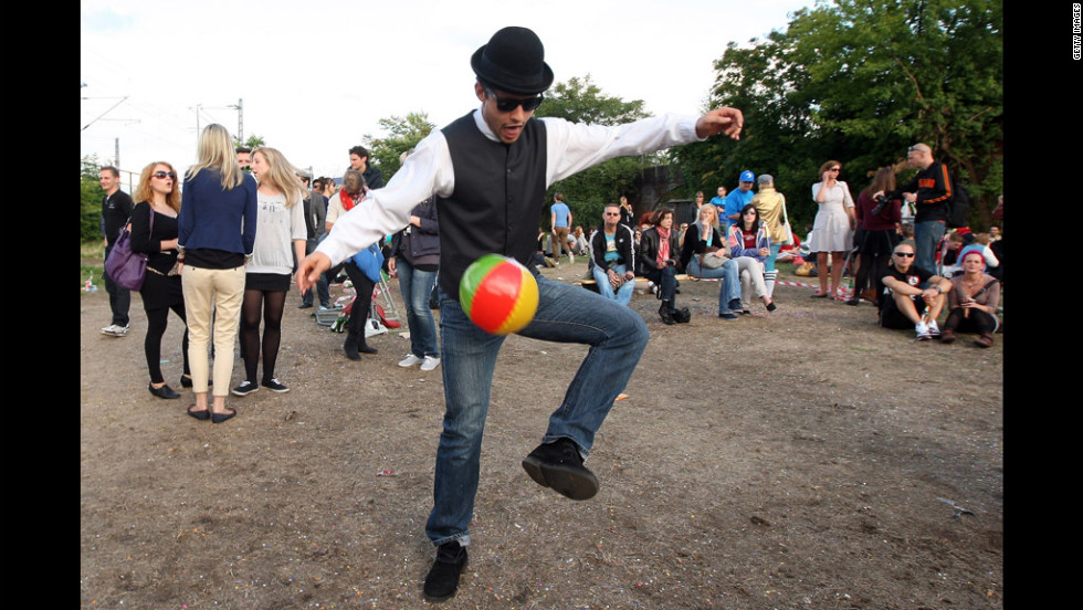 A man kicks a beach ball during the festivities.