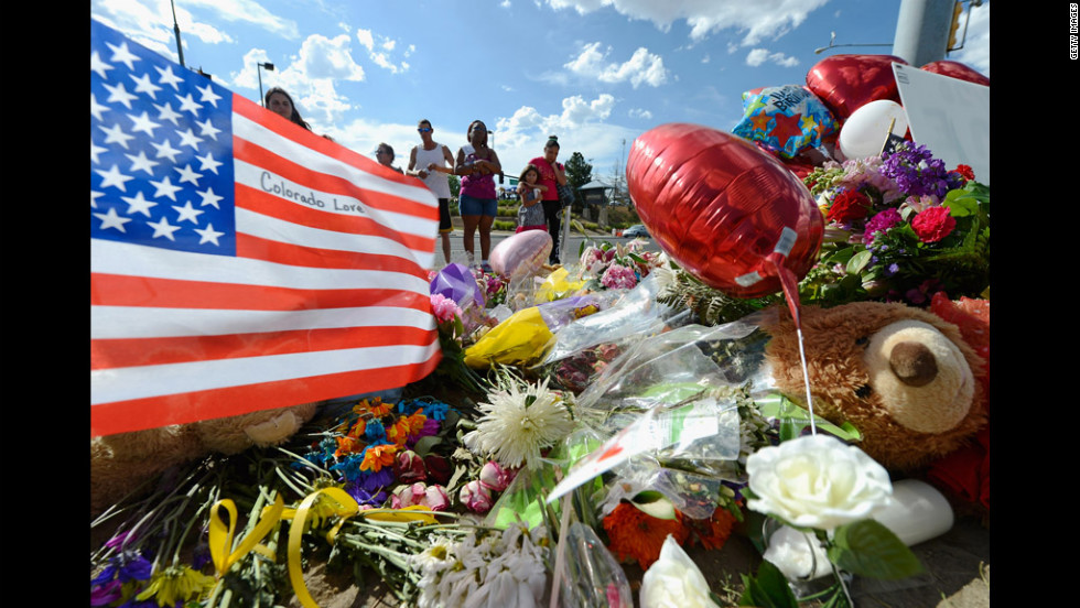 Tiffany Garcia, right, and her 6-year-old daughter, Angelina Garcia, cry on Saturday, July 21, as they look at a memorial for the victims of Friday's shooting.