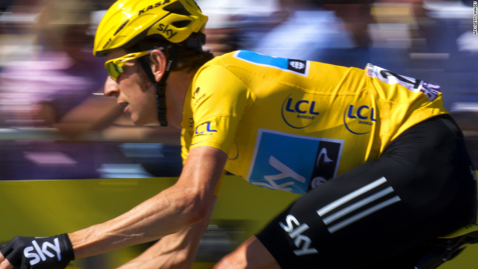 Race winner Bradley Wiggins riding on the Champs Elysees on the final stage of the 2012 Tour de France.