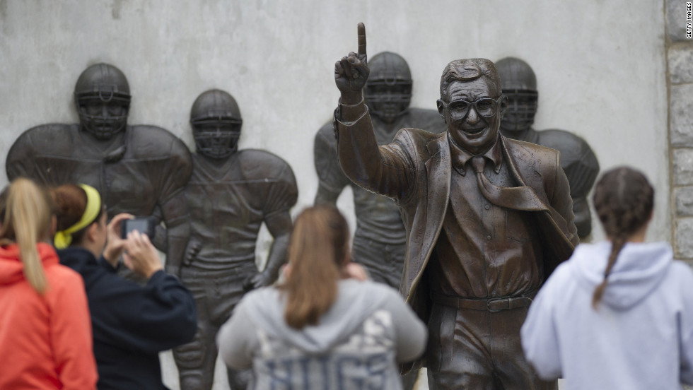 Visitors gather around the Paterno statue on Saturday, July 21.