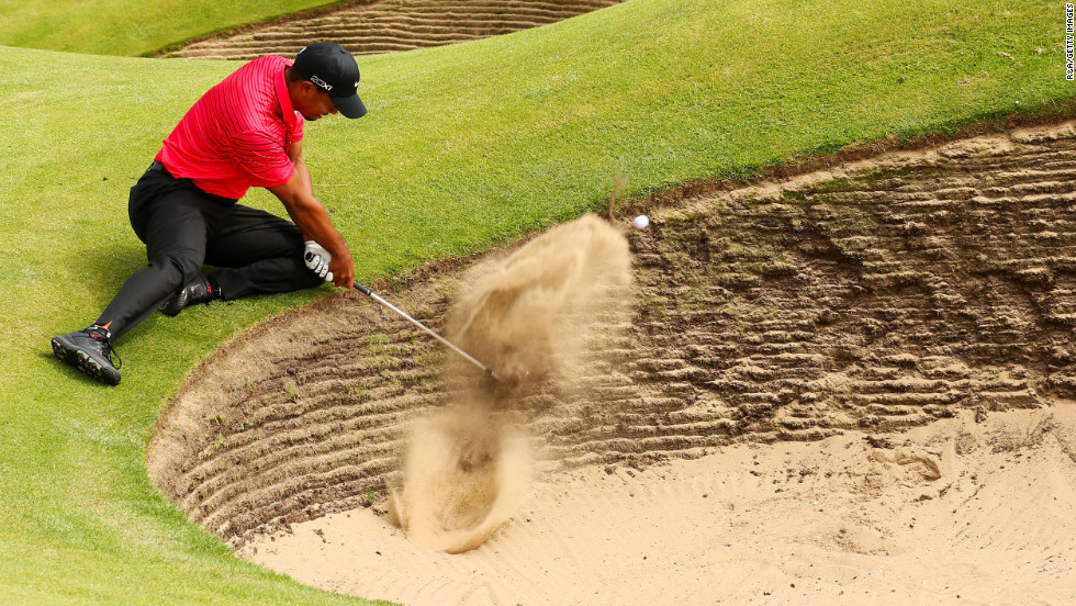 Tiger Woods of the United States tries to works his way out of a bunker on the sixth hole Sunday.