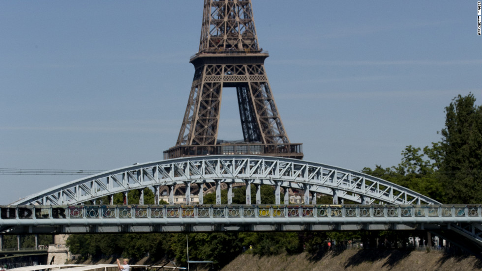 The peloton rides towards the Eiffel Tower in Paris on Sunday for the ceremonial finish on the Champs-Elysees.