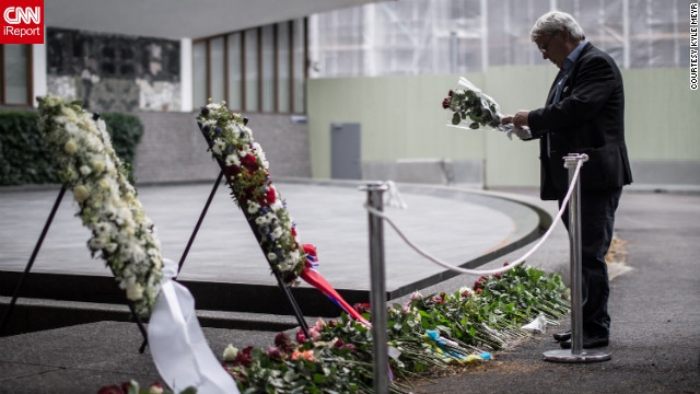 Citizens mourn and pay respects to victims of the attacks on Oslo and Utøya a year later.