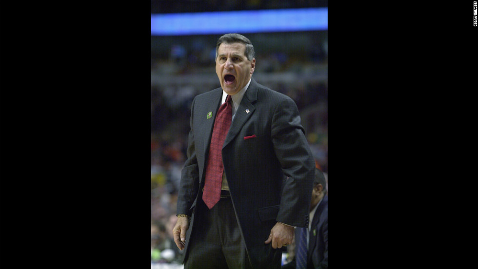 Jim Harrick Sr., then head coach of the University of Georgia Bulldogs, yells from the sidelines during the 2002 NCAA Division I men's basketball tournament. Harrick resigned as UGA's head basketball coach in 2003 after his son, Jim Harrick Jr., was accused of giving an A to three basketball players who didn't attend class and paying a phone bill for one of them. The NCAA punished UGA with four years' probation, and the school was forced to vacate 30 wins from 2001-2003.