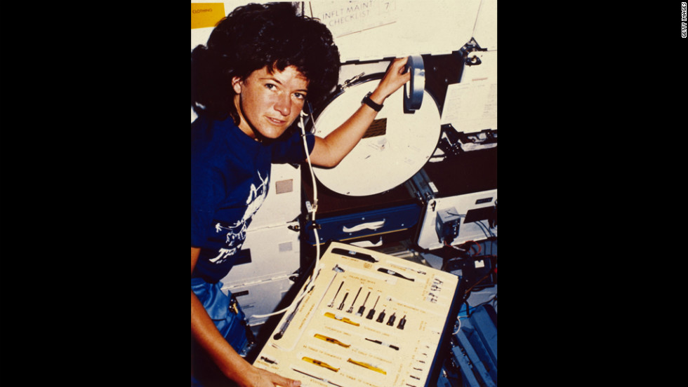 Ride inspects a tool kit during orbit. She also traveled to space aboard the Challenger in 1984. She had been assigned to a third flight as well, but that was scratched after the deadly Challenger explosion in 1986.
