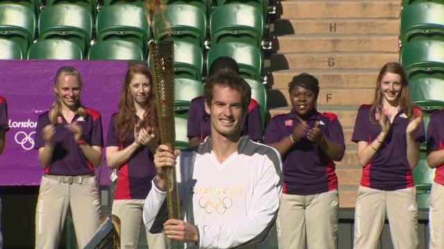 Andy Murray carries the Olympic torch