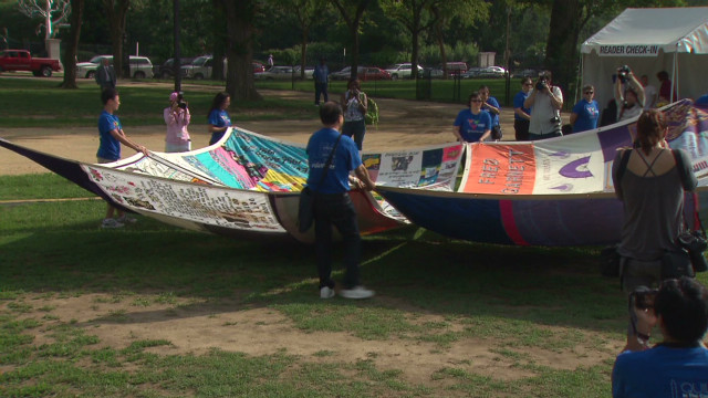 AIDS quilt is unfolded for conference