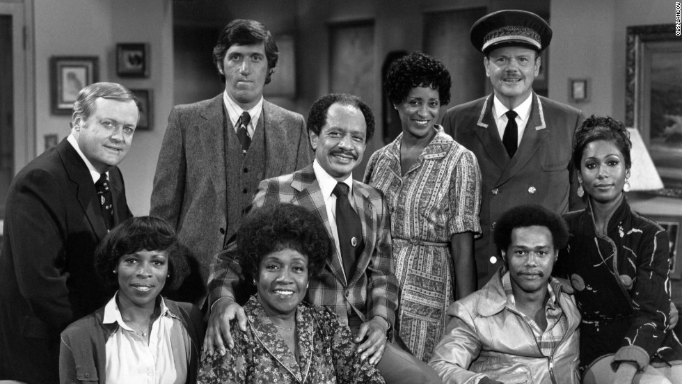 """The Jeffersons"": (Back row, from left) Franklin Cover, Paul Benedict, Sherman Hemsley, Marla Gibbs and Ned Wertimer. (Front row, from left) Roxie Roker, Isabel Sanford, Mike Evans and Berlinda Tolbert."