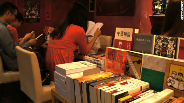 Customers sit and read books on Chinese politics inside People's Commune in Causeway Bay, Hong Kong.