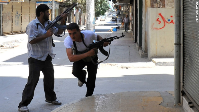 Fighters from the Syrian opposition clash with forces loyal to President Bashar al-Assad, in the center of Syria's restive northern city of Aleppo on July 25, 2012.