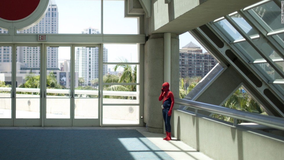 Spider-Man takes a call in a quiet corner of the San Diego Convention Center.