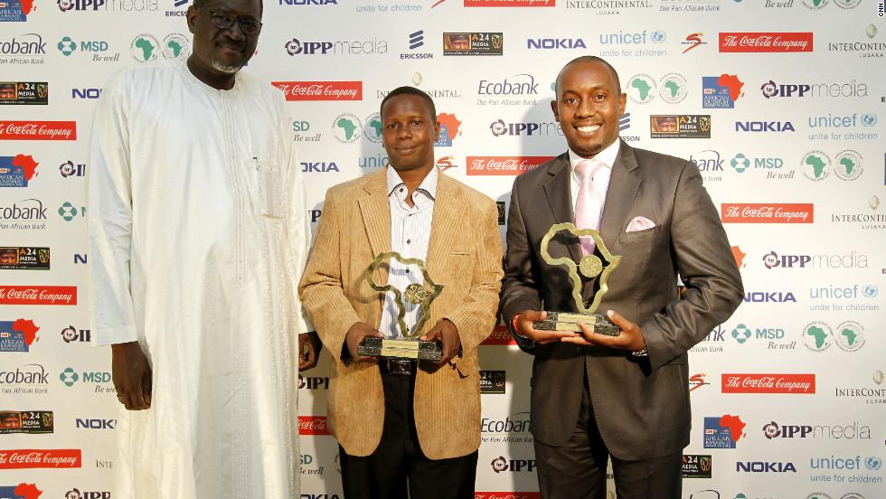 Kenyan journalist Nimrod Taabu Mwagamoyo poses with joint winner Charles Kinyua Kariuki after they receive the award for Television News Bulletin.