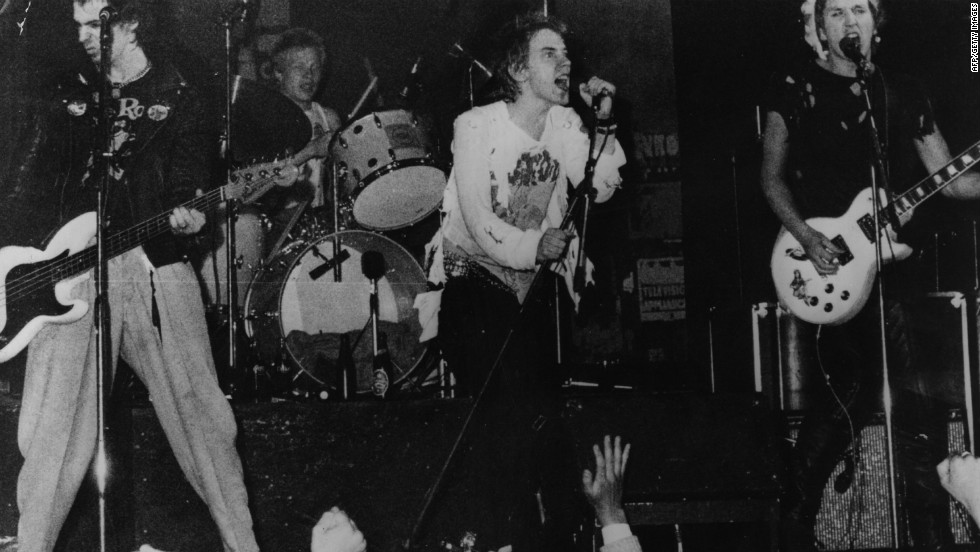 "Infamous British punk rock group The Sex Pistols playing live in Copenhagen in 1977. Though banned by the BBC during their time as an act, their song ""Pretty Vacant"" was included in the Danny Boyle-directed Olympic opening ceremony."