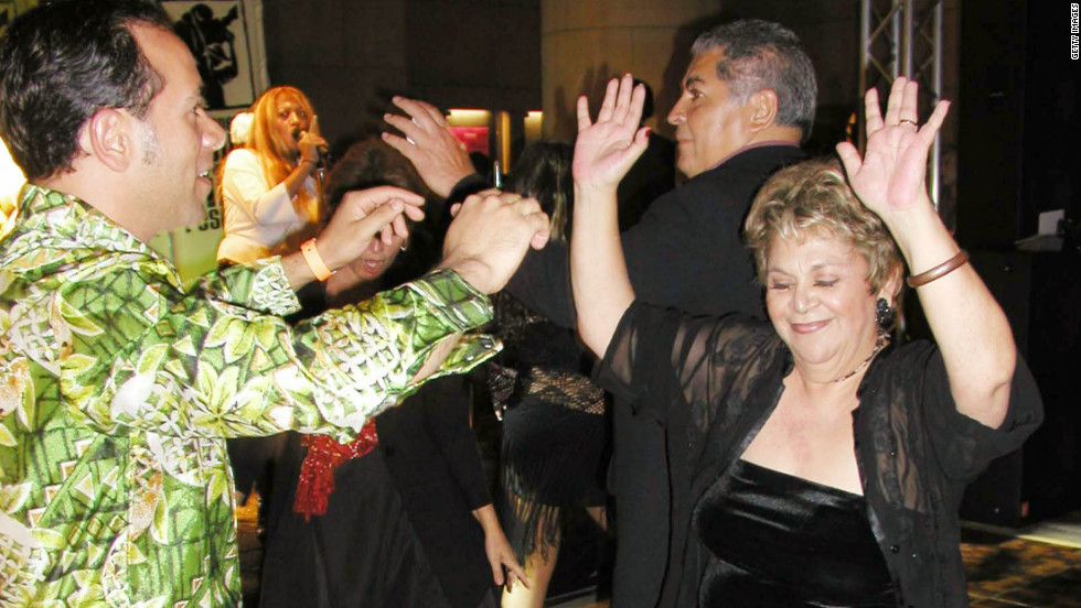 Jose Alberto and Ontiveros dance at a 2003 after-party for the Los Angeles Latino International Film Festival in Hollywood.