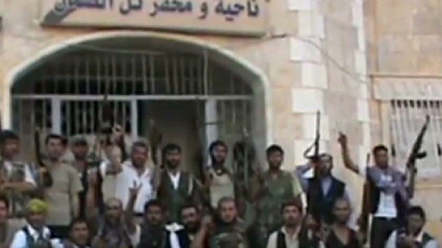 Syria rebels: We took police station