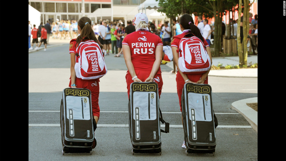 Dejected Russian athletes fall short in the Olympic bellhop race.