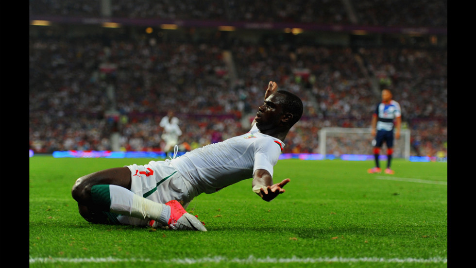 Moussa Konate of Senegal practices for the Olympic limbo competition.