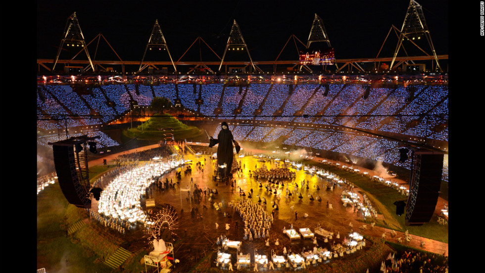General view taken as actors perform during the opening ceremony.