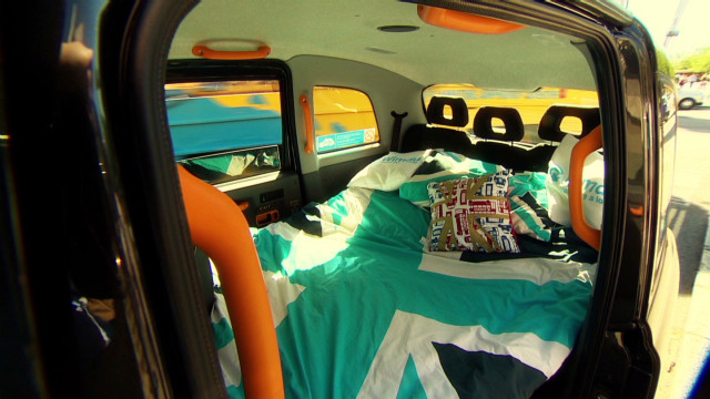 Cabbie turns taxi into hotel for Games