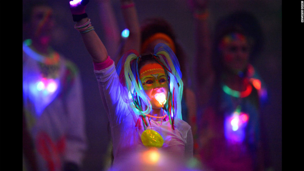An artist performs with a glowing pacifier during the opening ceremony.