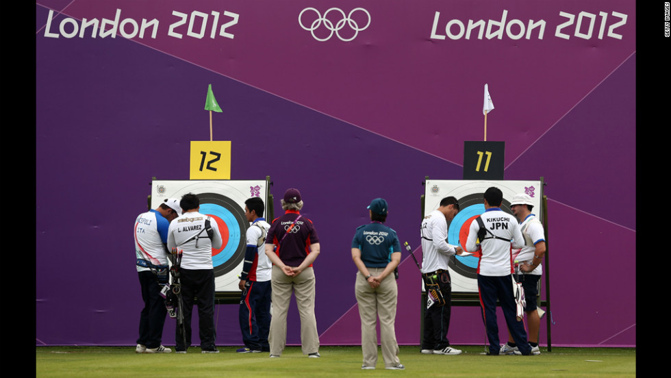 Competitors inspect targets Friday during the Archery Ranking Round at the Lord's Cricket Ground in London.