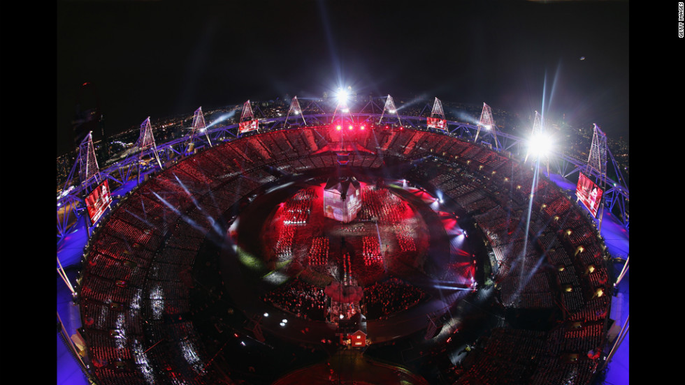 The Olympic stadium lit up in red and blue during the opening ceremony.