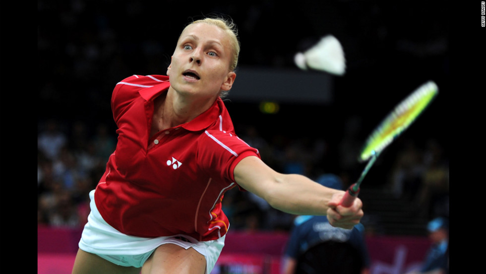 Kamila Augustyn of Poland looks for a shot against Anastasia Prokopenko of Russia during the women's singles badminton match.