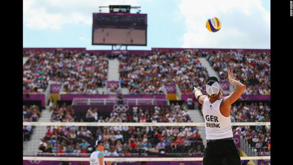 Julius Brink of Germany spikes the ball during the men's beach volleyball match against Russia.