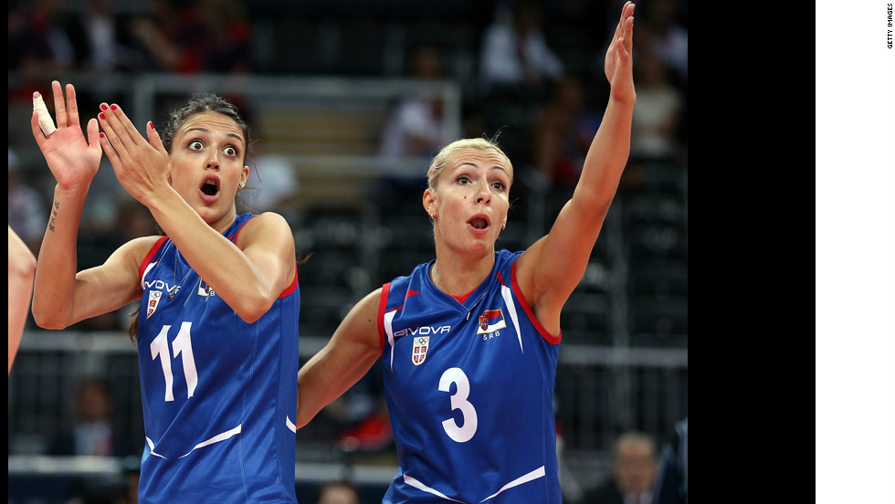 Stefana Veljkovic, No. 11, and Ivana Djerisilo, No. 3, of Serbia react to a lost point to China during the women's volleyball game.