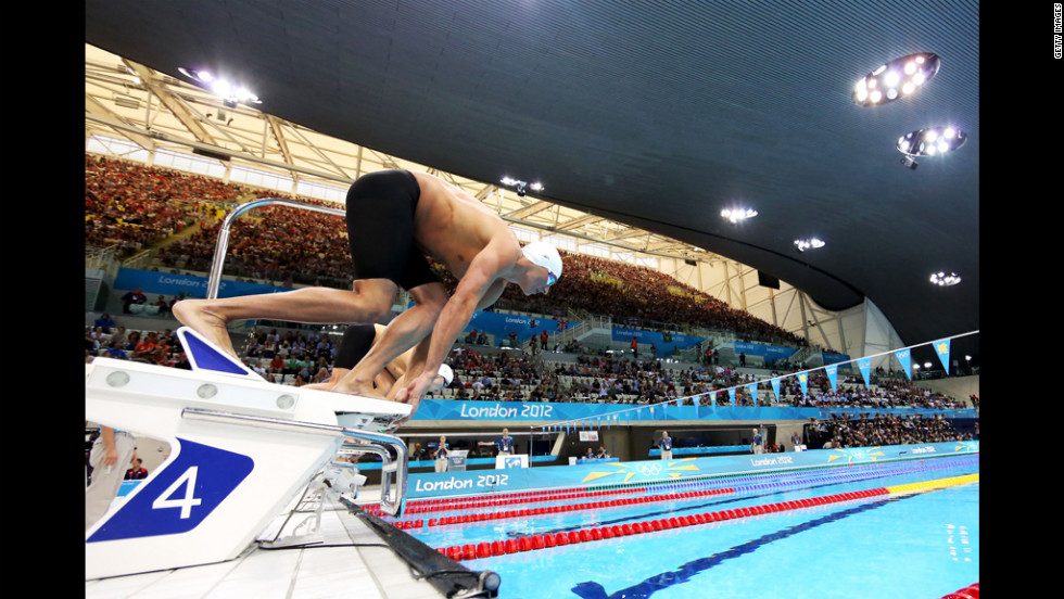 U.S. swimmer Ryan Lochte dives off of the starting block at the start of heat five of the men's 400-meter individual medley.