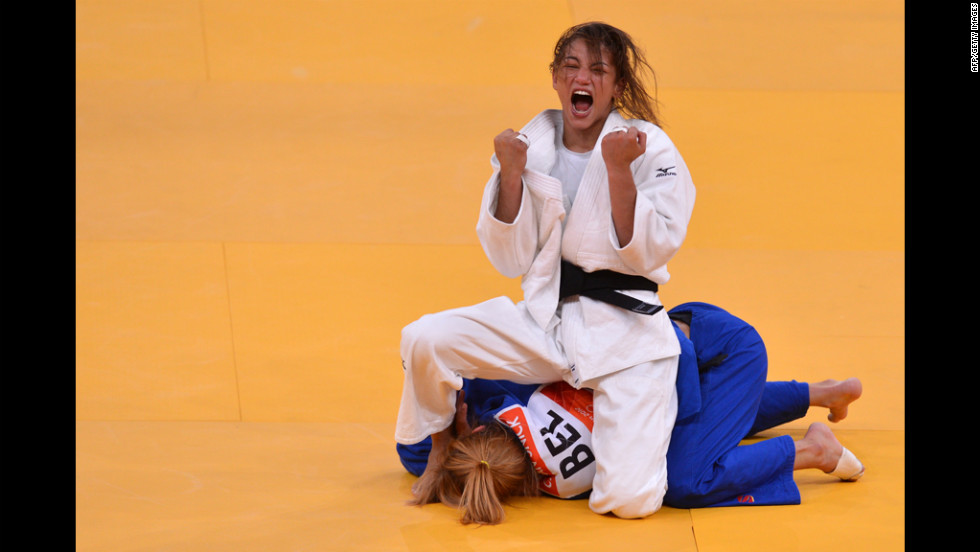 Brazil's Sarah Menezes (top) celebrates after beating Belgium's Charline Van Snick in the semi-final judo match.