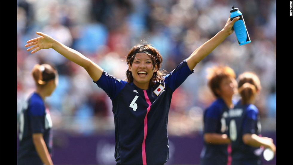 Saki Kumagai of Japan waves to the crowd after playing in a first-round women's soccer game between Japan and Sweden.