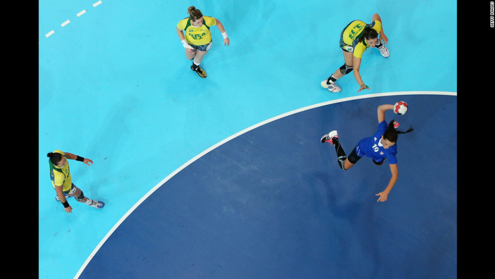 Maja Zebic of Croatia attacks the goal in women's handball preliminaries between Croatia and Brazil.
