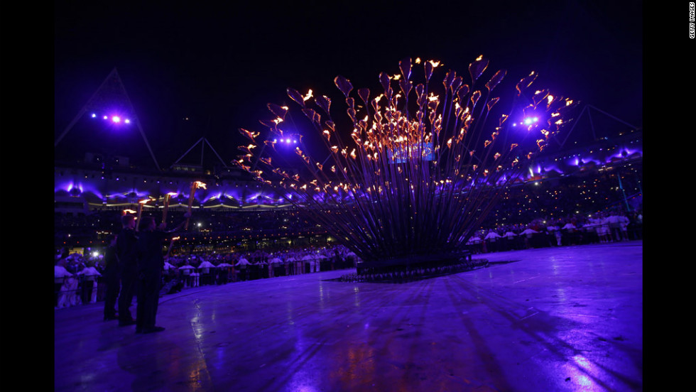 The athletes ignited an outer rim of torches, setting off a chain reaction, spreading fire to other pieces until the cauldron was engulfed.