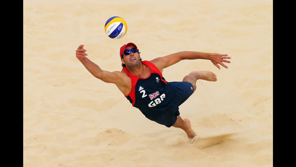 Steve Grotowski of Great Britain dives for the ball during the men's beach volleyball preliminary round.