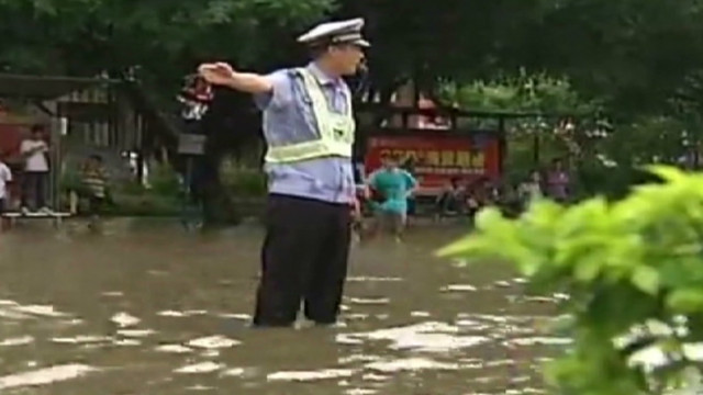 Major road in China, knee-deep in water