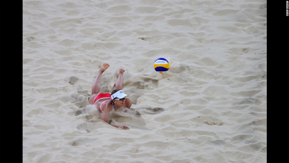 Nadine Zumkehr of Switzerland dives for the ball against Greece during the women's beach volleyball preliminaries.