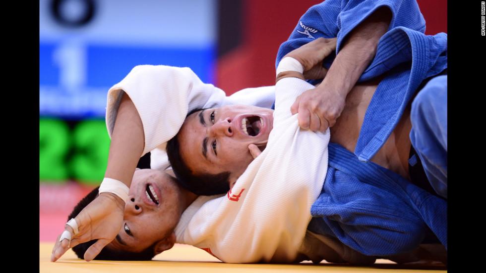 Mongolia's Tumurkhuleg Davaadorj, left, competes with Brazil's Felipe Kitadai during a judo match.
