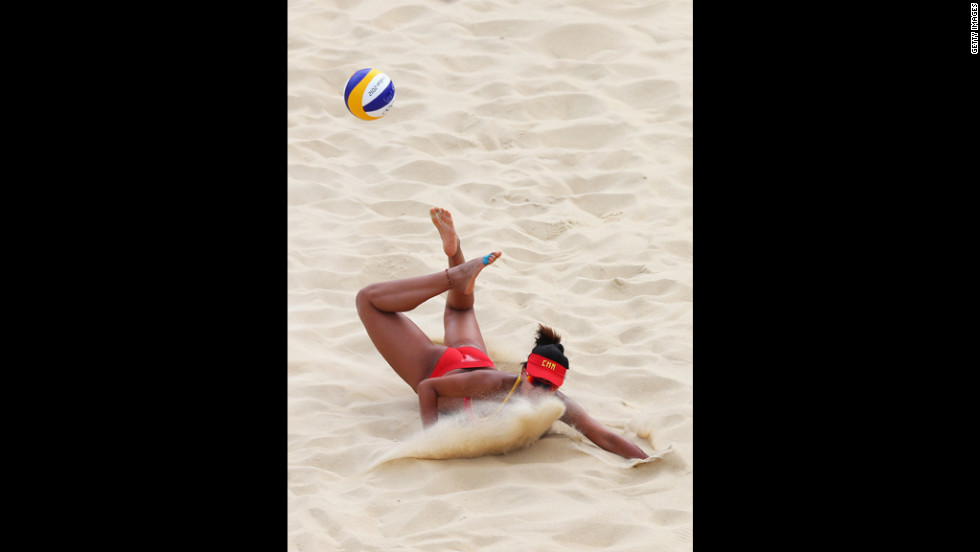 "Chen Xue of China dips to return the ball during the women's beach volleyball match between China and Russia. See photos from <a href=""http://www.cnn.com/2012/07/29/worldsport/gallery/olympics-day-two/index.html"" target=""_blank"">day two of the games.</a>"