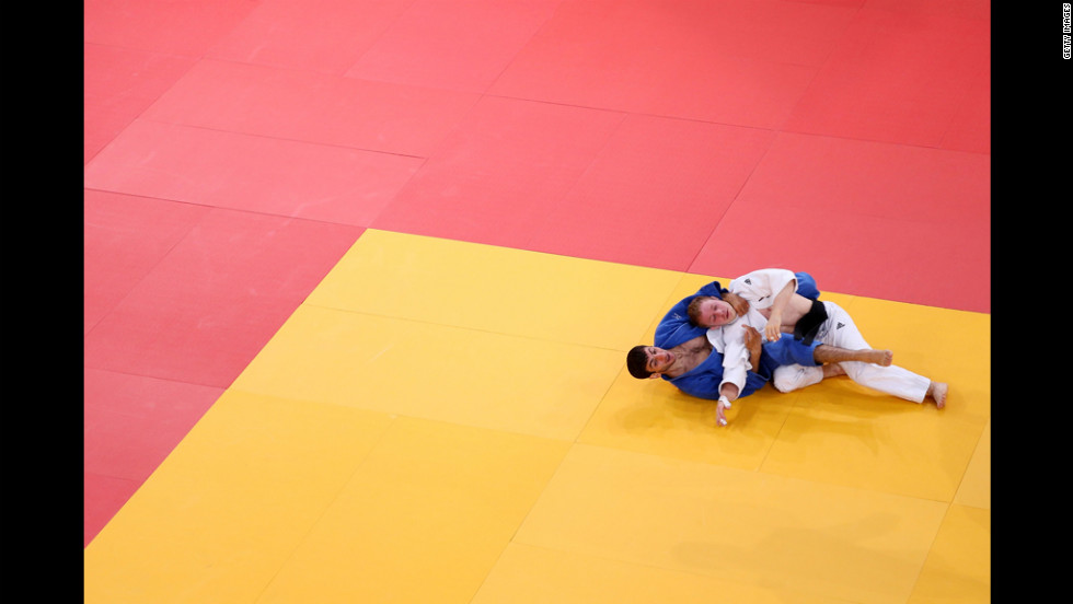 "Tobias Englmaier of Germany, in white, and Hovhannes Davtyan of Armenia compete in the men's judo competition. See photos from <a href=""http://www.cnn.com/2012/07/29/worldsport/gallery/olympics-day-two/index.html"" target=""_blank"">Day 2 of the competition.</a>"