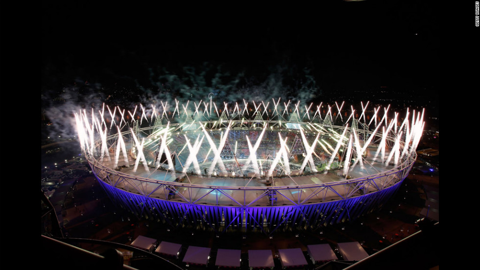 Fireworks ignite over the Olympic Stadium.