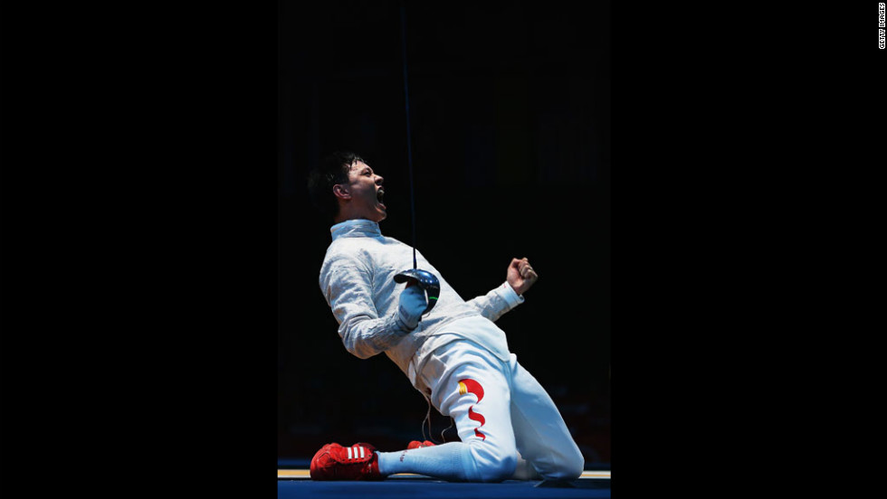 China's Man Zhong celebrates after winning the men's saber individual fencing round against South Korea's Junghwan Kim.