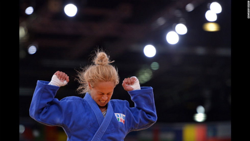Italy's Rosalba Forciniti celebrates after winning against South Korea's Kyung-Ok Kim during the women's under 52-kilogram judo match.