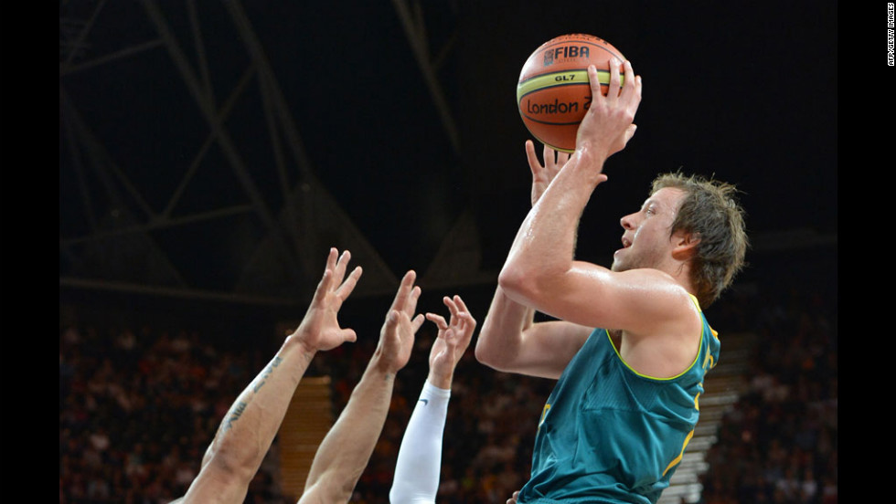 Australian forward Joe Ingles shoots during a men's preliminary round basketball match against Brazil.