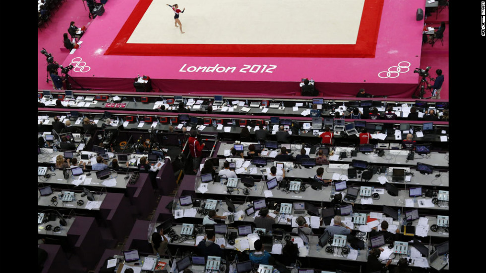 A gymnast performs on the floor during the women's qualification of the artistic gymnastics event.
