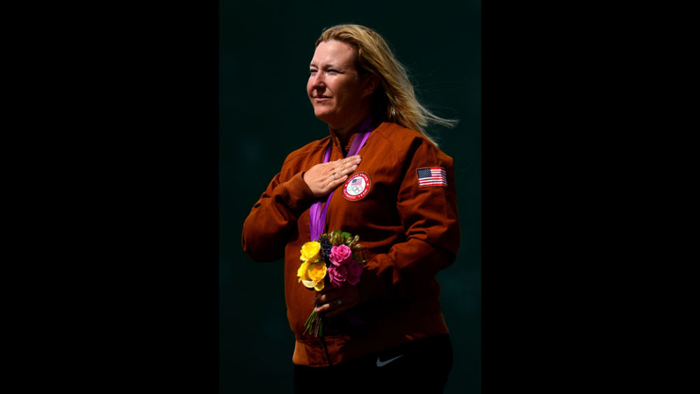 Kim Rhode listens to the U.S. national anthem after winning the gold medal in women's skeet shooting Sunday.